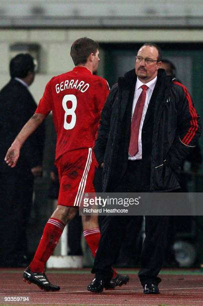 Steven Gerrard of Liverpool walks past Manager Rafael Benitez as he is substituted during the UEFA Champions League group E match between Debrecen...