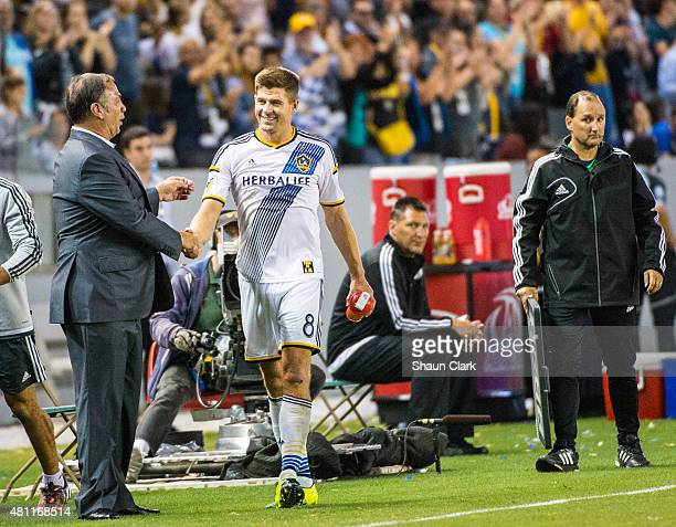 Steven Gerrard of Los Angeles Galaxy is congratulated by Coach Bruce Arena during Los Angeles Galaxy's MLS match against San Jose Earthquakes at the...
