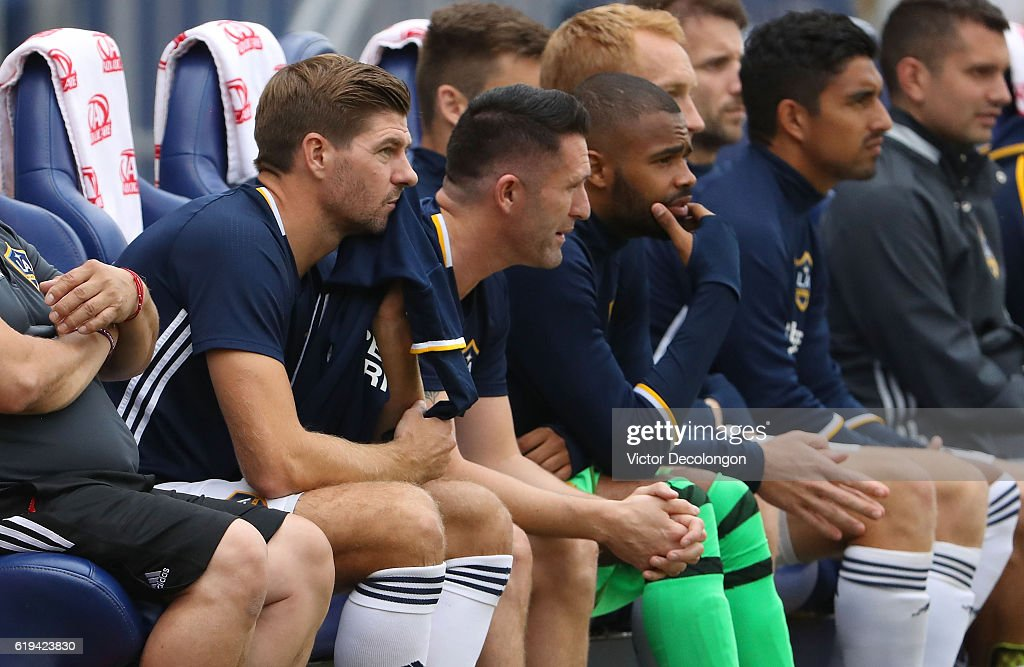 Steven Gerrard #8 of Los Angeles Galaxy, left, looks on from the bench area during the second half of leg one of the Audi 2016 MLS Cup Playoff Western Conference Semfinal between the Colorado Rapids and the Los Angeles Galaxy at StubHub Center on October 30, 2016 in Carson, California. The Galaxy defeated the Rapids 1-0 in leg one of the two game playoff Western Conference Semifinal series.