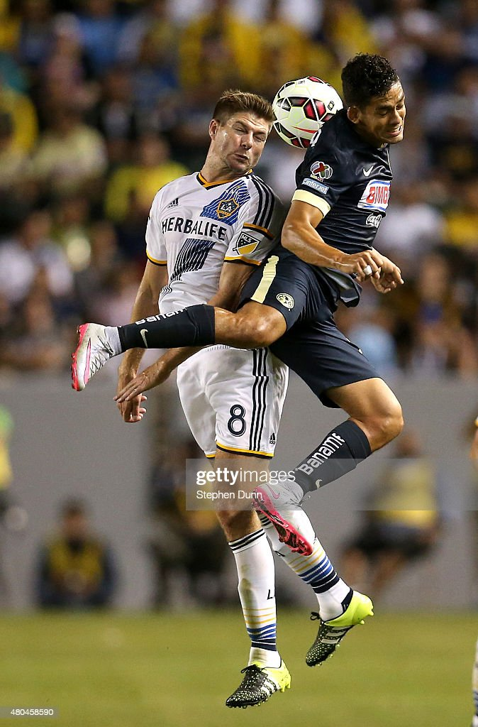 Steven Gerrard #8 of the Los Angeles Galaxy jumps to head the ball against Andres Andrade #8 of Club America in the International Champions Cup 2015 at StubHub Center on July 11, 2015 in Los Angeles, California.