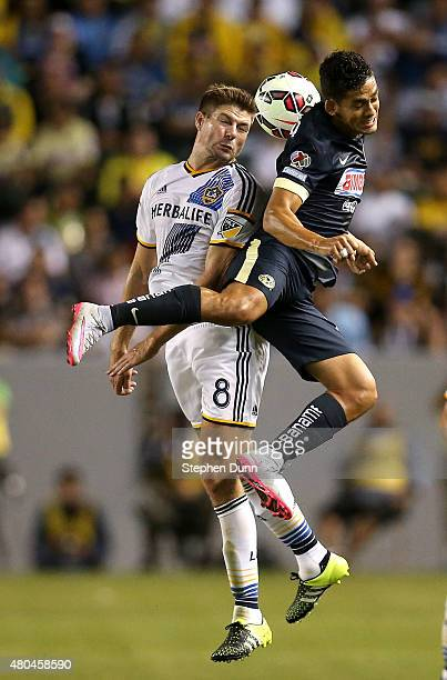 Steven Gerrard of the Los Angeles Galaxy jumps to head the ball against Andres Andrade of Club America in the International Champions Cup 2015 at...