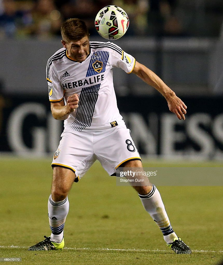 Steven Gerrard #8 of the Los Angeles Galaxy passes the ball off his head against Club America in the International Champions Cup 2015 at StubHub Center on July 11, 2015 in Los Angeles, California.