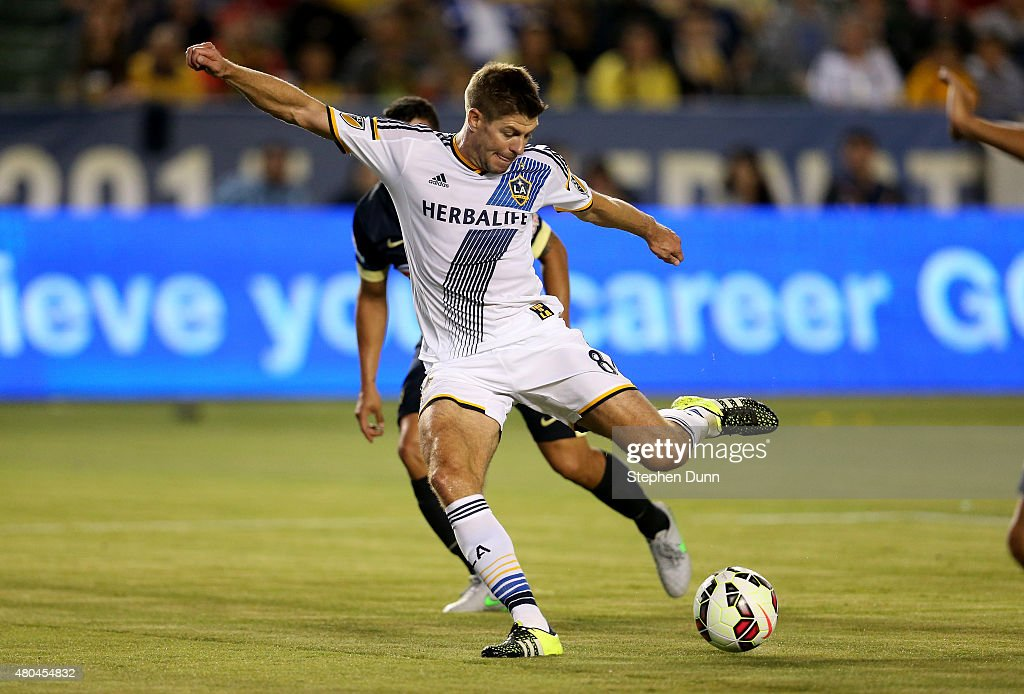 Steven Gerrard #8 of the Los Angeles Galaxy takes a shot on goal against Club America in the International Champions Cup 2015 at StubHub Center on July 11, 2015 in Los Angeles, California.