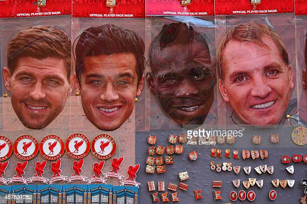 Steven Gerrard Philippe Coutinho Mario Balotelli and Brendan Rodgers face masks are displayed for sale at a stall outside the stadium before the...