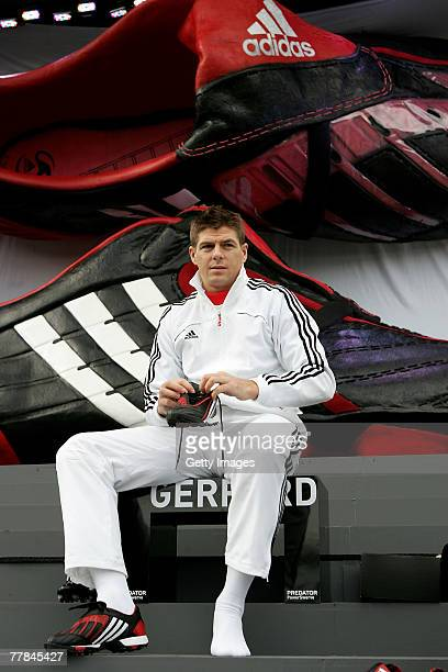 Steven Gerrard puts on his Predator boots during the adidas Predator Launch event at Place Du Trocadero on November 11 2007 in Paris France