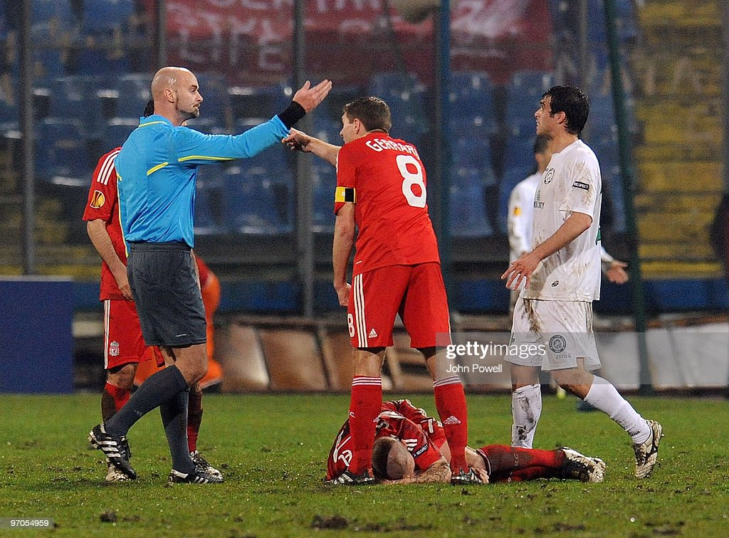 Steven Gerrard reacts after Martin Skrtel goes down injured during the UEFA Europa League knock-out round, second leg match between FC Unirea Urziceni and Liverpool FC at Unirea Valahorum Stadium, Urziceni on February 25, 2010 in Bucharest, Romania.