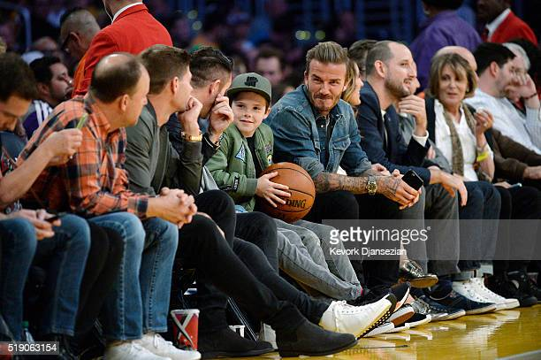 Steven Gerrard Robbie Keane Romeo Beckham Cruz Beckham and David Beckham attend a basketball game between the Boston Celtics and the Los Angeles...