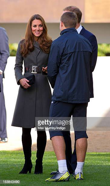 Steven Gerrard talks with Catherine Duchess of Cambridge and Prince William Duke of Cambridge as they attend the official launch of The Football...