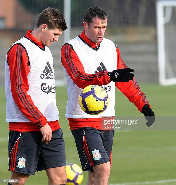 Steven Gerrard talks with Jamie Carragher during a Liverpool FC training session at Melwood Training Ground on February 5 2010 in Liverpool England