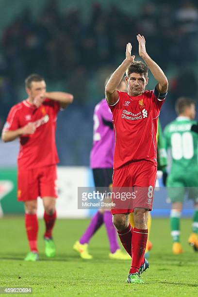 Steven Gerrard the captain of Liverpool applauds the travelling fans after his sides 22 draw during the UEFA Champions League Group B match between...