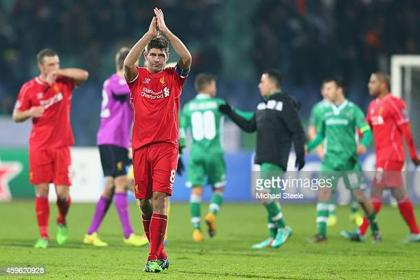 Steven Gerrard the captain of Liverpool applauds the travelling fans after his sides 2-2 draw during the UEFA Champions League Group B match between...