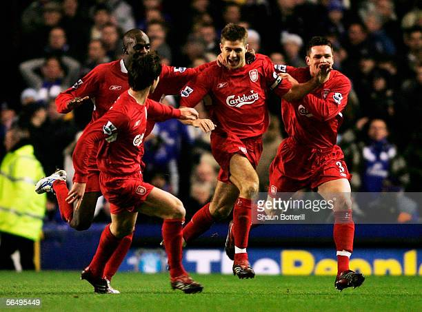 Steven Gerrard, the Liverpool captain, celebrates with team-mates after scoring during the Barclays Premiership match between Everton and Liverpool...