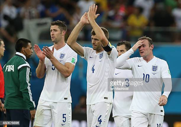 Steven Gerrard Wayne Rooney and Gary Cahill walk from the field during the opening Group D match of the 2014 World Cup between England and Italy at...