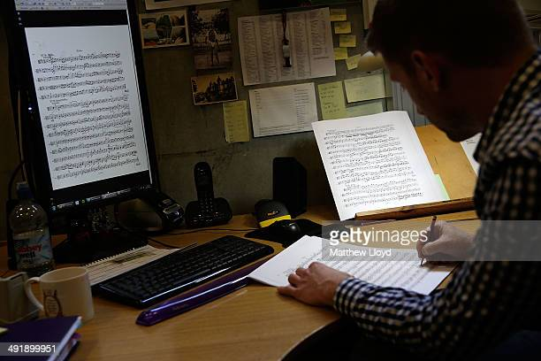 Steven Gietzen from Glyndebourne's Music Library hand marks a score for Mozart's Don Giovanni one of six operas appearing in the 2014 Glyndebourne...