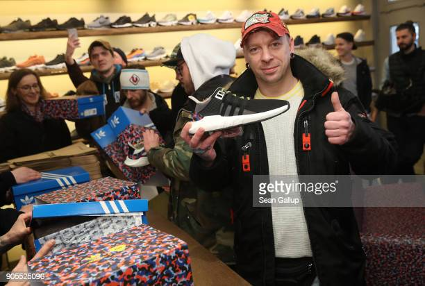 Steven gives the thumbs up as holds his justpurchased very limited edition adidas EQT Support 93/Berlin shoes after waiting with three buddies...