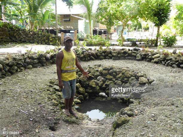 Steven Hari a Busu village resident in the Solomon Islands points to a fresh water well built by his ancestors roughly 150 years ago on Nov 4 2017...