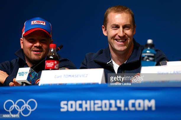 Steven Holcomb and Curt Tomasevicz of the United States attend a Men's Bobsleigh team press conference ahead of the Sochi 2014 Winter Olympics at the...