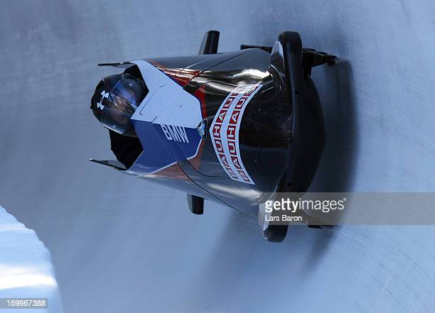 Steven Holcomb and his brakeman Steven Langton of USA take a run during a training session at Olympia Bob Run on January 24 2013 in St Moritz...