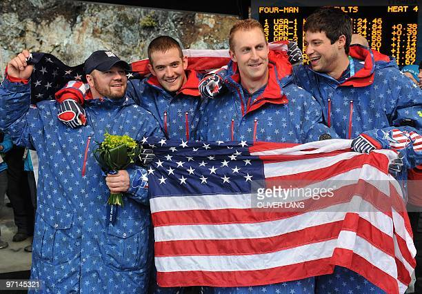 Steven Holcomb Justin Olsen Curtis Tomasevicz and Steve of the USA1 fourman bobsleigh team celebrate winning gold in the 4man bobsleigh event at the...