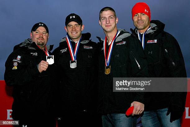 Steven Holcomb Justin Olsen John Napier Charles Berkeley pose for photographers on the winner's podium after the 2man bobsled competition during the...