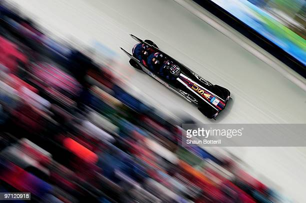 Steven Holcomb Justin Olsen Steve Mesler and Curtis Tomasevicz of the Unites States compete in USA 1 during the fourman bobsleigh heat 2 on day 15 of...