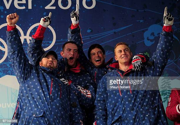 Steven Holcomb Justin Olsen Steve Mesler and Curtis Tomasevicz of USA 1 celebrate after winning the gold medal during the men's four man bobsleigh on...