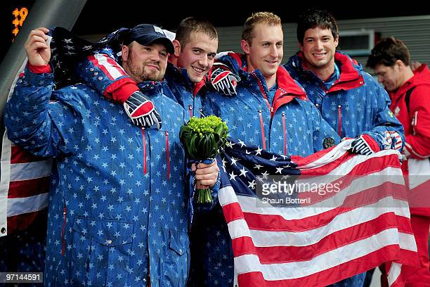 Steven Holcomb Justin OlsenCurtis Tomasevicz and Steve Mesler of USA 1 celebrate after winning the gold medal during the men's four man bobsleigh on...