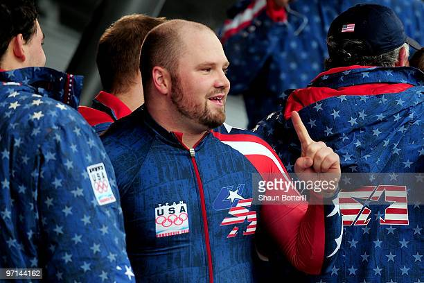 Steven Holcomb of USA 1 celebrates after winning the gold medal during the men's four man bobsleigh on day 16 of the 2010 Vancouver Winter Olympics...