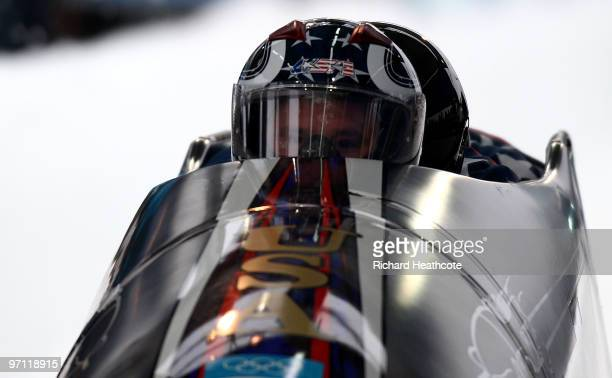 Steven Holcomb teammates Justin Olsen Steve Mesler and Curtis Tomasevicz of the Unites States compete in USA 1 during the fourman bobsleigh heat 1 on...