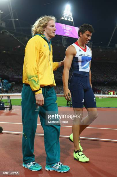Steven Hooker of Australia speaks with Steven Lewis of Great Britain during the Men's Pole Vault Final on Day 14 of the London 2012 Olympic Games at...