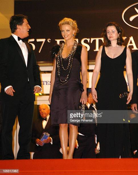 "Steven Hopkins, Charlize Theron, and Emily Watson during 2004 Cannes Film Festival - ""The Life and Death of Peter Sellers"" Departures at Palais Du..."