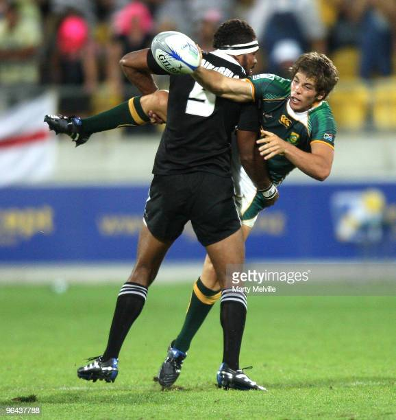 Steven Hunt of South Africa gets a pass away as he is tackled by Lote Raikabula of New Zealand in the match between New Zealand and South Africa...