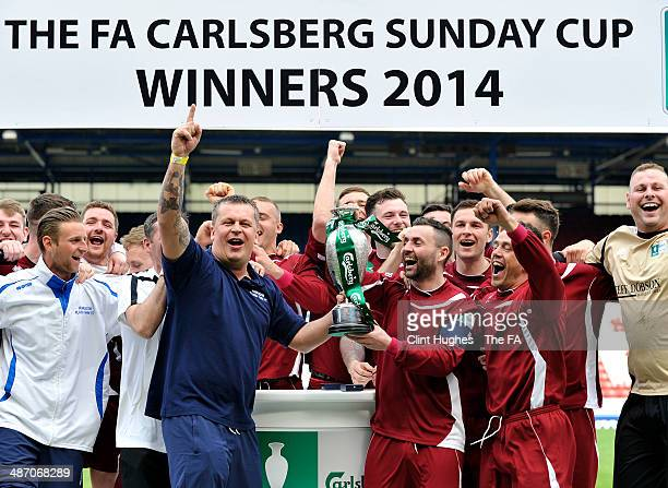 Steven Hutchinson and Michael Coghlan of Humbledon Plains Farm lift the FA Carlsberg Sunday Cup Trophy after their sides victory during the FA Sunday...