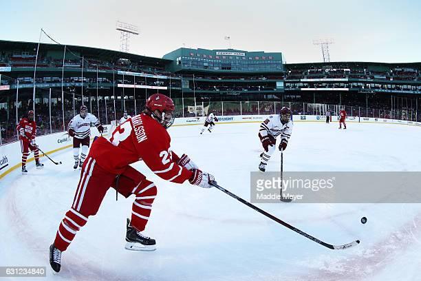 Steven Iacobellis of the Massachusetts Minutemen defends Jakob Forsbacka Karlsson of the Boston University Terriers at Fenway Park on January 8 2017...