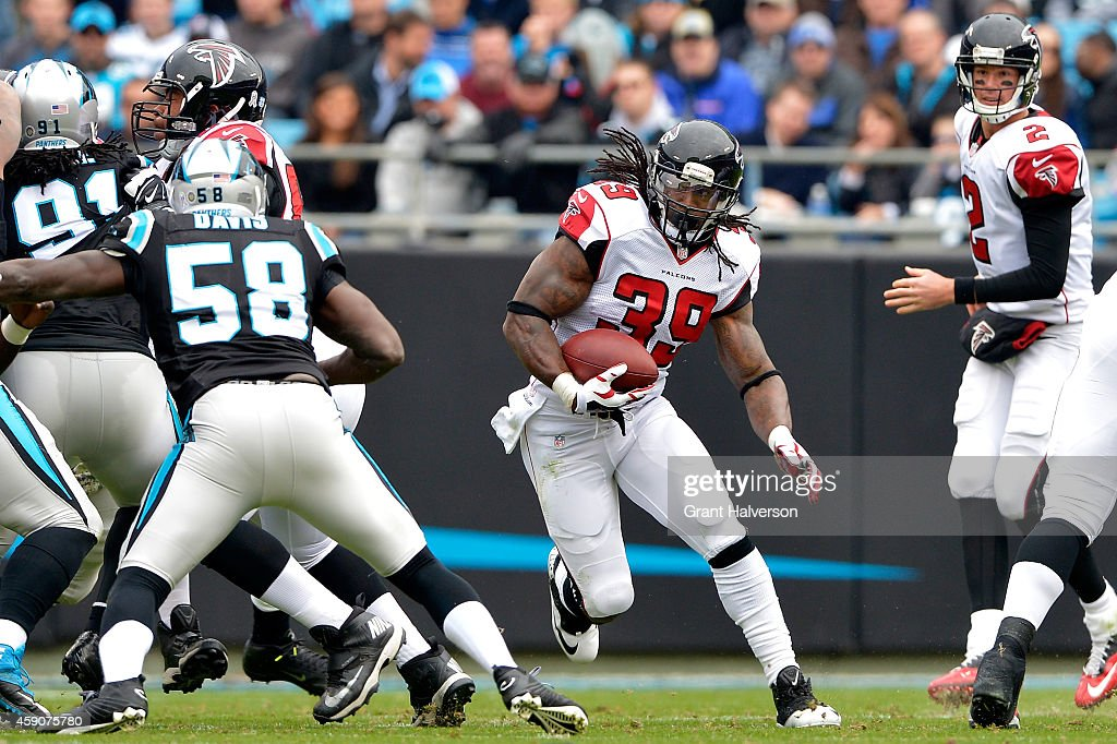 Steven Jackson #39 of the Atlanta Falcons runs the ball against the Carolina Panthers in the first quarter during their game at Bank of America Stadium on November 16, 2014 in Charlotte, North Carolina.