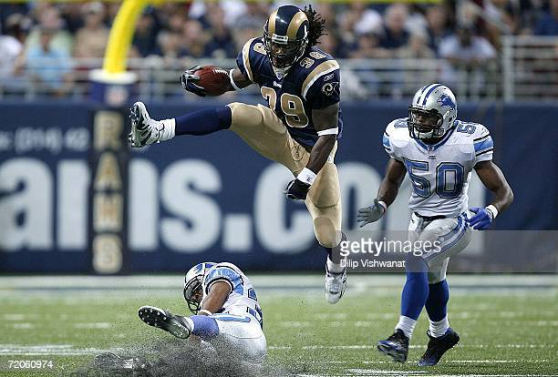 Steven Jackson of the St Louis Rams hurdles Dre Bly of the Detroit Lions as Bly's teammate Ernie Sims at the Edward Jones Dome on October 1 2006 in...