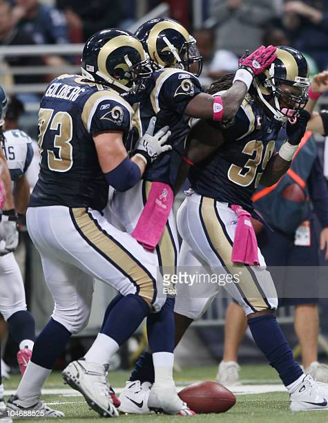 Steven Jackson of the St Louis Rams is congratulated by teammates Kenneth Darby and Adam Goldberg in the fourth quarter against the Seattle Seahawks...