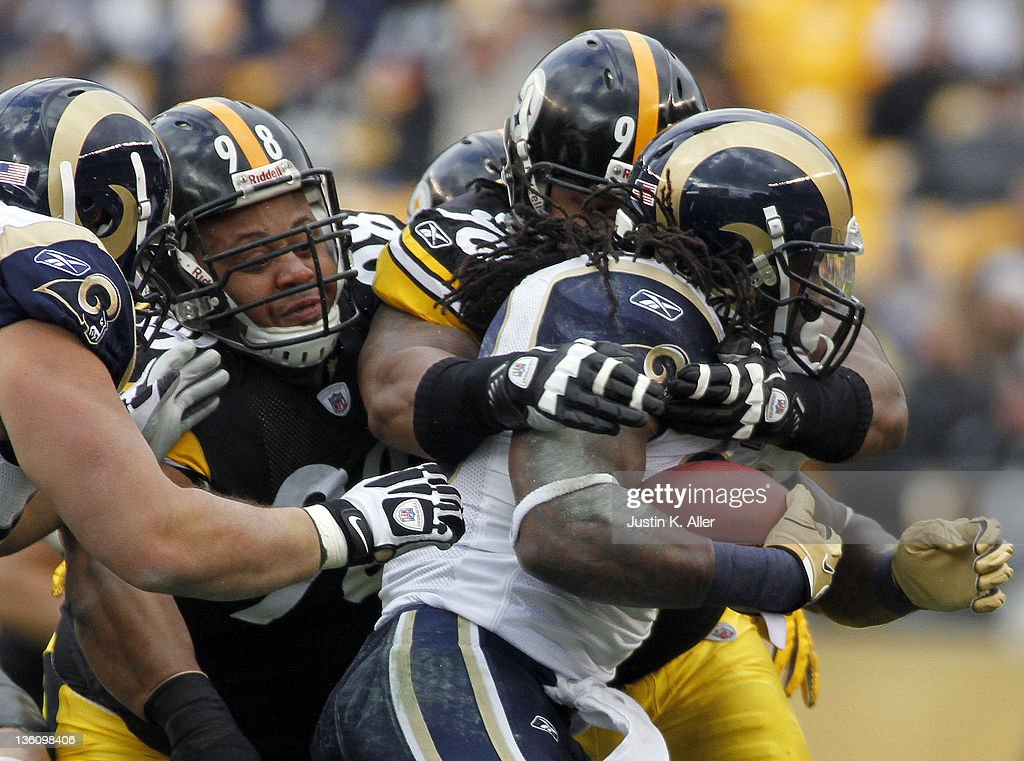 Steven Jackson #39 of the St. Louis Rams is tackled by Steve McLendon #90 and Casey Hampton #98 of the Pittsburgh Steelers during the game on December 24, 2011 at Heinz Field in Pittsburgh, Pennsylvania.