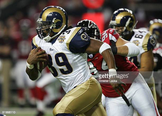 Steven Jackson of the St Louis Rams runs against the defense of the the Atlanta Falcons during first half of the NFC Divisional Playoff game at the...