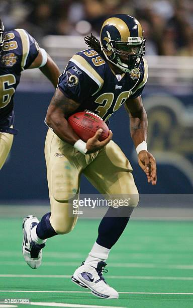 Steven Jackson of the St. Louis Rams runs with the ball against the Seattle Seahawks during the game on November 14, 2004 at the Edward Jones Dome in...