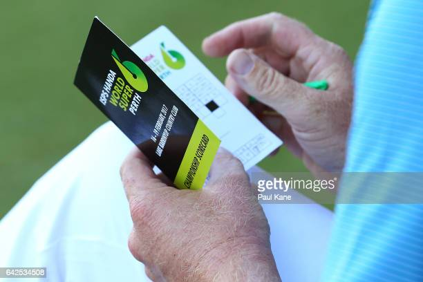 Steven Jeffress of Australia checks his scorecard on the 18th green after completing his round during round three of ISPS HANDA World Super 6 Perth...