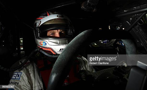Steven Johnson driver of the Jim Beam Racing Ford sits in his car prior to qualifying for race 11 for round six of the V8 Supercar Championship...