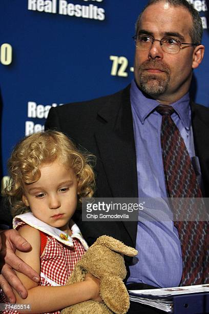 Steven Johnson holds his daughter, 4-year-old Zara, during a news conference in the run up to a series of U.S. Senate votes on stem cell research at...