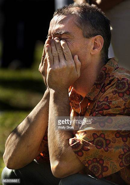 Steven Jones son of cult leader Jim Jones listens to a speaker during a memorial service on the 25th anniversary of the Jonestown murder and suicide...