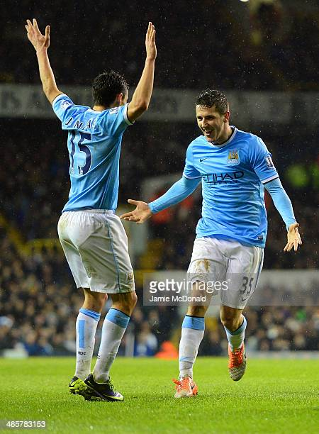 Steven Jovetic of Manchester City celebrates scoring their fourth goal during the Barclays Premier League match between Tottenham Hotspur and...