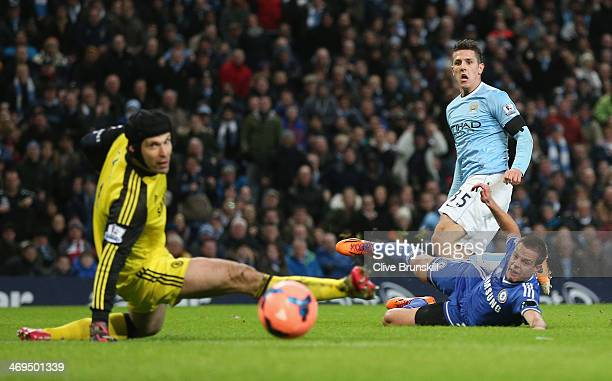 Steven Jovetic of Manchester City scores the first goal past Petr Cech of Chelsea during the FA Cup Fifth Round match sponsored by Budweiser between...
