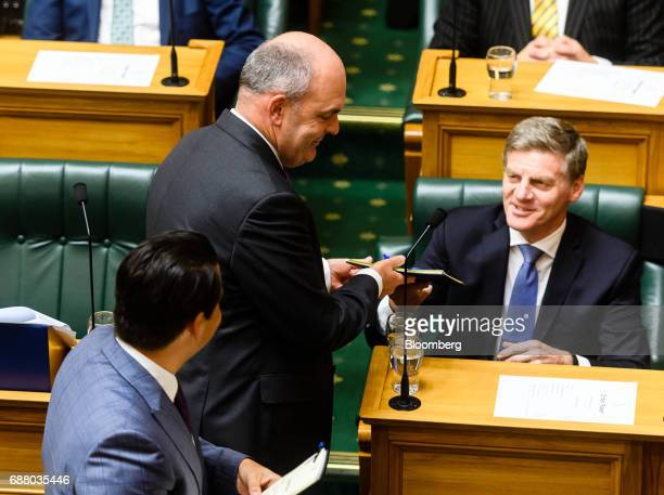 Steven Joyce New Zealand's finance minister center arrives to deliver the budget as prime minister Bill English right looks on at the parliament in...