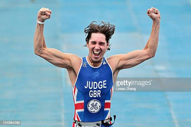 Steven Judge of Great Britain celebrates in the paratriathlon male TRI-3 as he crosses the line during the 2011 ITU World Championship Grand Final at...
