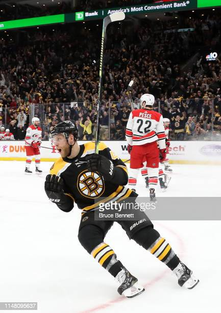 Steven Kampfer of the Boston Bruins celebrates after scoring a goal during the first period in Game One of the Eastern Conference Final against the...