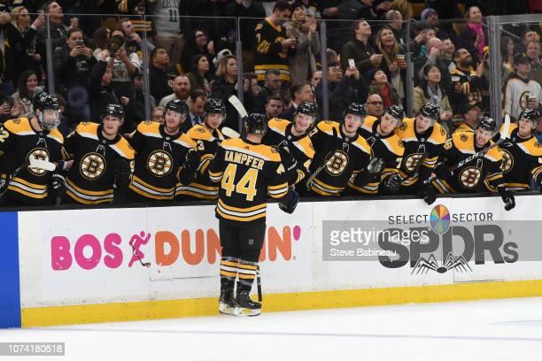 Steven Kampfer of the Boston Bruins celebrates his goal against the Buffalo Sabres at the TD Garden on December 16 2018 in Boston Massachusetts